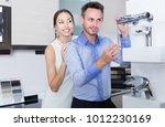 smiling family couple choosing... | Shutterstock . vector #1012230169