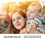 mother and her baby outdoors in ... | Shutterstock . vector #1012232431