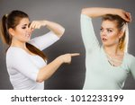 woman having wet armpit her... | Shutterstock . vector #1012233199