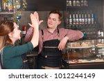 great teamwork of two barista...   Shutterstock . vector #1012244149