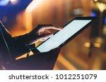 girl holding in hands on blank... | Shutterstock . vector #1012251079