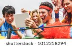happy supporters from different ... | Shutterstock . vector #1012258294