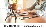 woman vlogger using laptop... | Shutterstock . vector #1012261804