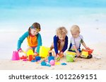 child playing on tropical beach.... | Shutterstock . vector #1012269151