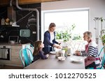 a small girl with mother and... | Shutterstock . vector #1012270525