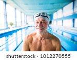 senior man standing in an... | Shutterstock . vector #1012270555