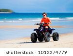 teenager riding quad bike on... | Shutterstock . vector #1012274779