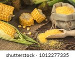 fresh corn on cobs on rustic... | Shutterstock . vector #1012277335