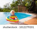 baby in swimming pool. little... | Shutterstock . vector #1012279201