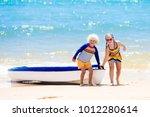 Kids Kayaking In Ocean....