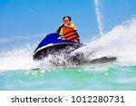 teenager on jet ski. teen age... | Shutterstock . vector #1012280731