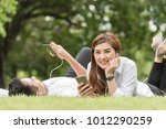 couple use smartphone together... | Shutterstock . vector #1012290259