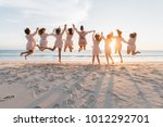 bride and bridesmaid to jump   Shutterstock . vector #1012292701