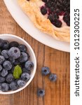 blueberry tart on white dish.  | Shutterstock . vector #1012300225