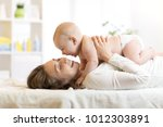 baby and smiley young mother... | Shutterstock . vector #1012303891
