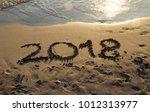 new year 2018 on a beach sand...   Shutterstock . vector #1012313977