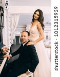 Small photo of Grand piano wedding bride and groom music