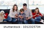 parents with children spending... | Shutterstock . vector #1012325734