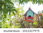 Colorful Bird House With Bird...