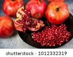 red juice pomegranate on black... | Shutterstock . vector #1012332319