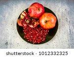 red juice pomegranate on black... | Shutterstock . vector #1012332325