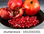 red juice pomegranate on black... | Shutterstock . vector #1012332331