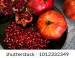 red juice pomegranate on black... | Shutterstock . vector #1012332349