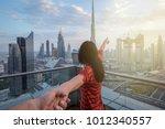 woman is leading her partner... | Shutterstock . vector #1012340557