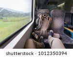 tourist backpacker riding train ... | Shutterstock . vector #1012350394