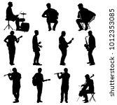 silhouettes street musicians... | Shutterstock . vector #1012353085