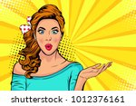 wow pop art face of surprised... | Shutterstock .eps vector #1012376161