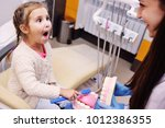 the dentist tells the child...   Shutterstock . vector #1012386355