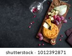 cheese platter with assorted... | Shutterstock . vector #1012392871