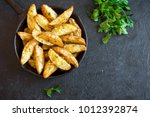 baked potato wedges with cheese ... | Shutterstock . vector #1012392874