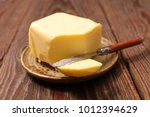 butter and knife | Shutterstock . vector #1012394629