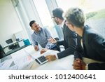 group of architects working on... | Shutterstock . vector #1012400641
