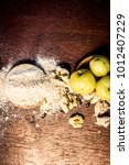 Small photo of Raw fresh ripe Phyllanthus emblica,amla or Indian gooseberry with its powder on wooden surface.