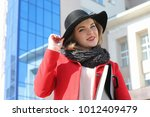 pretty girl on a walk in red... | Shutterstock . vector #1012409479
