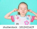 adorable little girl making... | Shutterstock . vector #1012421629