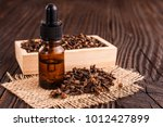 essential oil of cloves on a... | Shutterstock . vector #1012427899