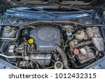 Small photo of Pitesti, Romania January 1, 2018 - Close up detail of an used and dirty Renault 1.6 litres, petrol (gasoline) engine. Concept of car maintenance, mechanical problems and dust penetration
