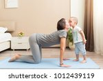 happy young sporty pregnant... | Shutterstock . vector #1012439119