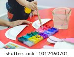 close up of paint brush in hand ... | Shutterstock . vector #1012460701