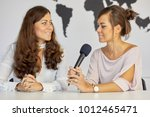 journalist talks with woman... | Shutterstock . vector #1012465471