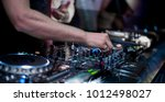 dj's hand playing music on the... | Shutterstock . vector #1012498027