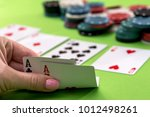 Small photo of two aces in the hands of a close-up
