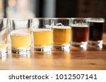 flight of craft beers in small... | Shutterstock . vector #1012507141