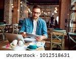 smart modern young man working... | Shutterstock . vector #1012518631