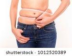 fat on the abdomen. fighting... | Shutterstock . vector #1012520389