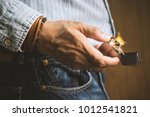 the man sparking his brushed... | Shutterstock . vector #1012541821